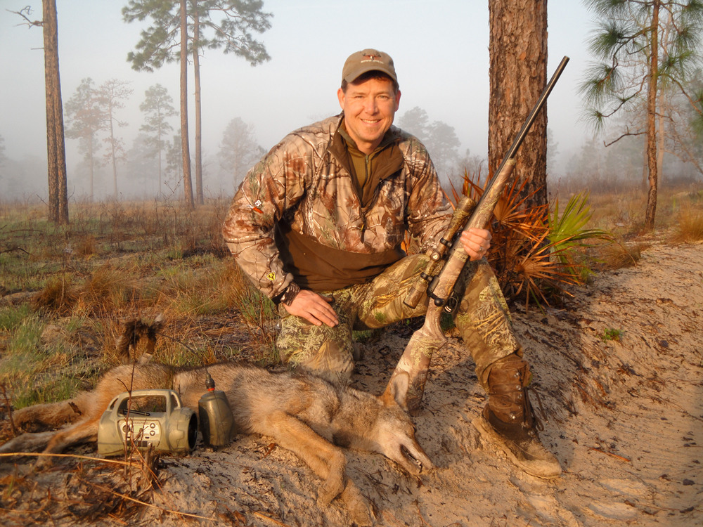 Fred Eichler with a coyote he harvested while coyote calling.