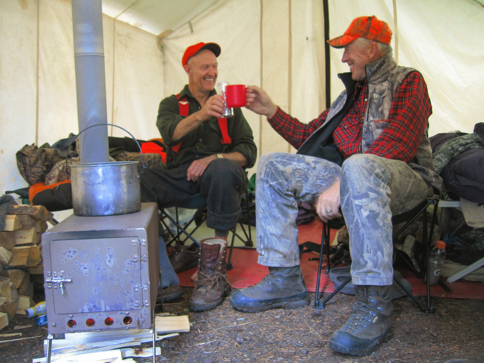George Bettas and a fellow hunter enjoying coffee around the stove