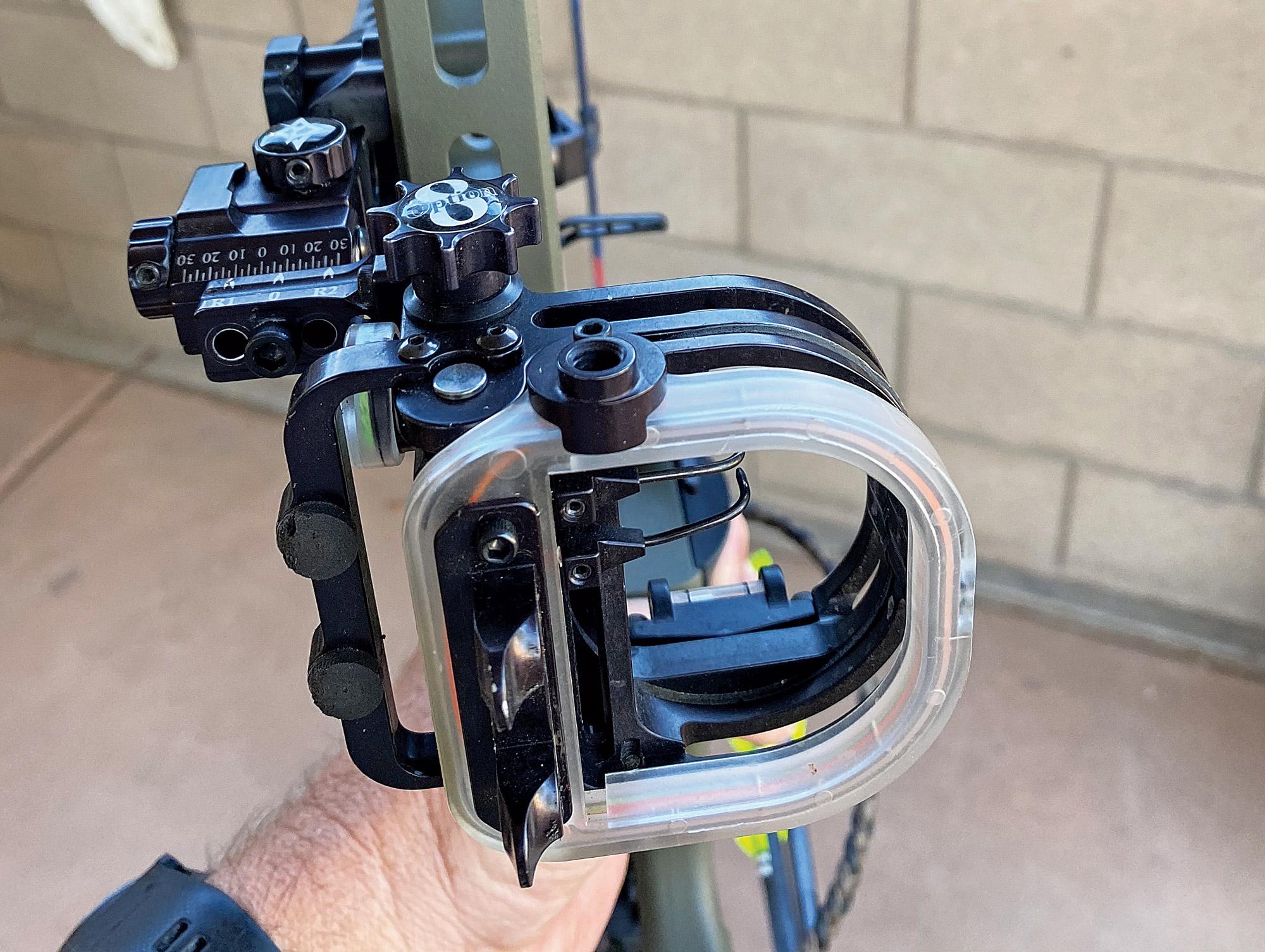 A bow sight attached to a Mathews VXR