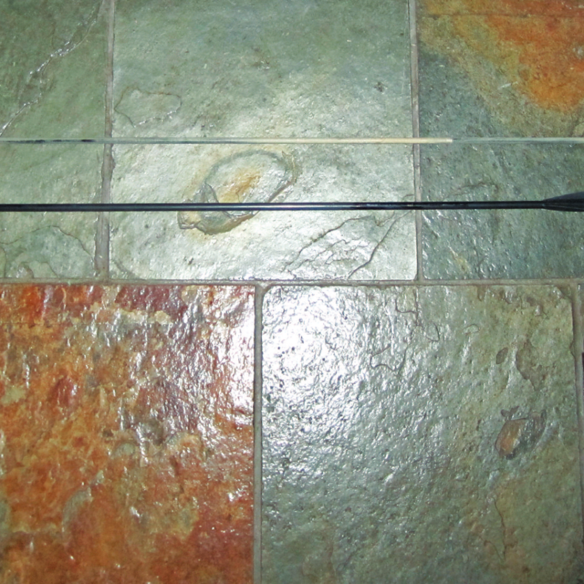 measuring out an elk hunting arrow using tile.